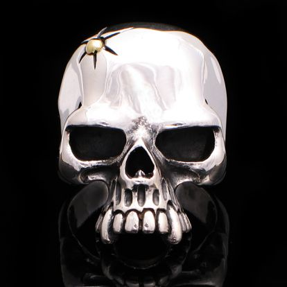 Skull ring with a bullet